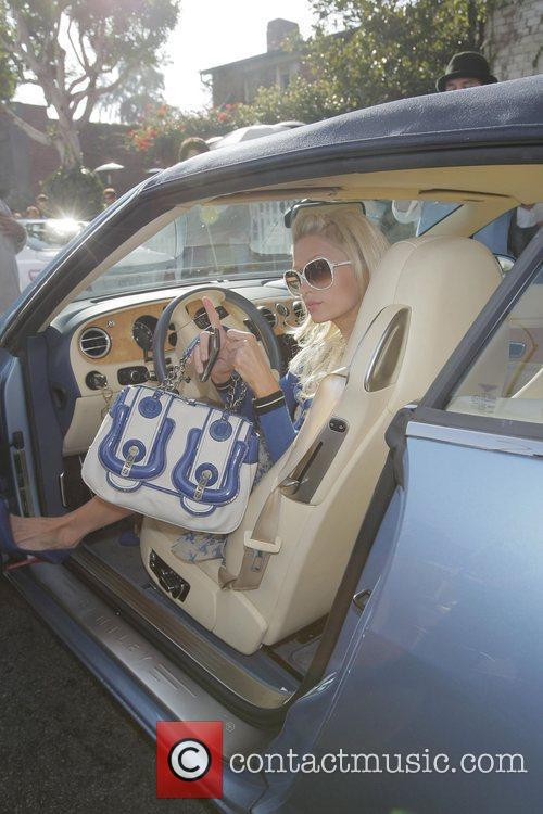 paris hilton arrives at the ivy restaurant in her blue bentley