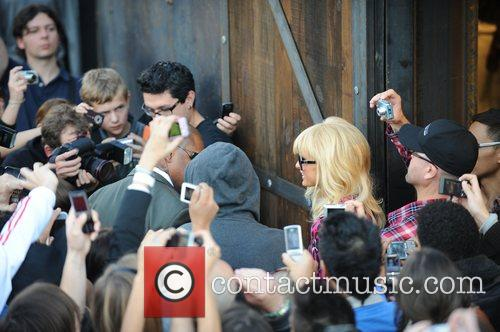 Paris Hilton is besieged by fans and photographers...