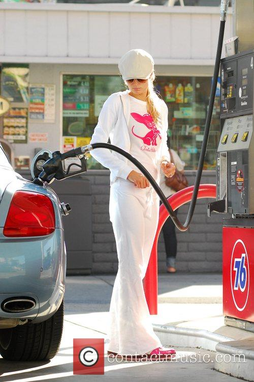 Paris Hilton At a gas station filling her...