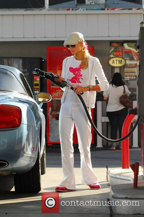 At a gas station filling her tank