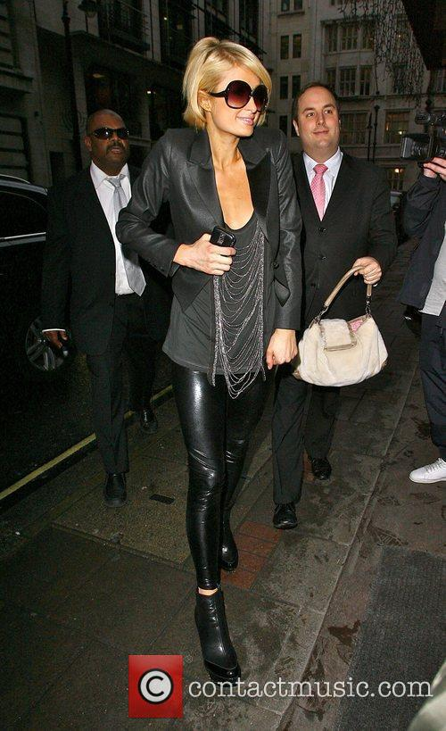 Paris Hilton returns to her hotel after a...