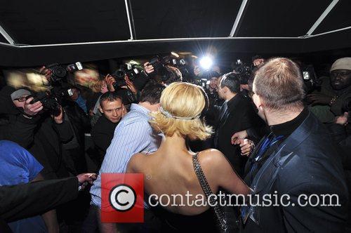 Paris Hilton with her boyfriend Doug Reinhardt leaving...