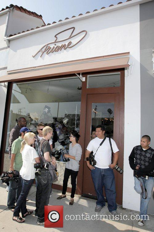 Paris Hilton shops at Ariane hat boutique while...