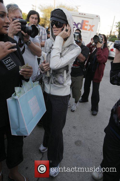 Paris Hilton is met by a frenzy of...