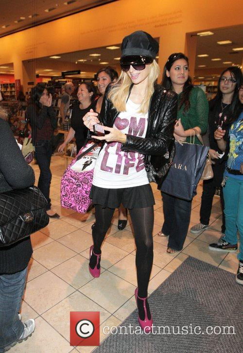Paris Hilton  shops at Borders in the...