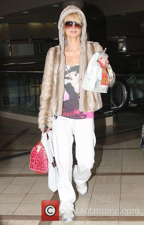 Paris Hilton arriving at LAX airport with McDonald's...