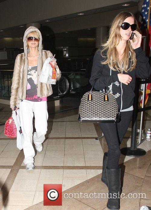 Paris Hilton and Nicky Hilton arriving at LAX...