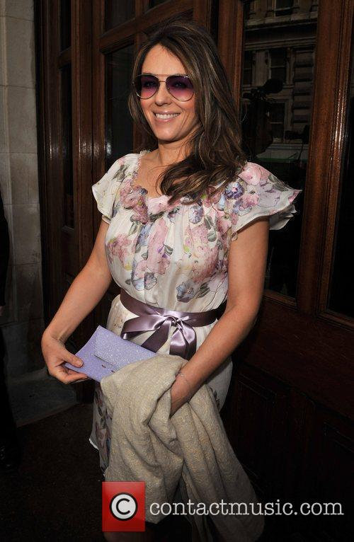 Liz Hurley arrives for the wedding of Patsy...