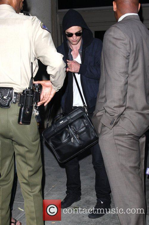 Amy Green and Robert Pattinson arrive at LAX...