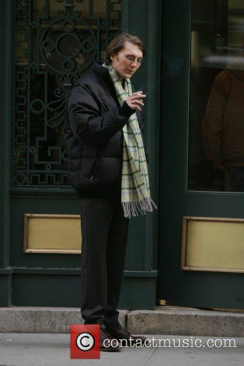 Paul Dano has a cigarette while out and...
