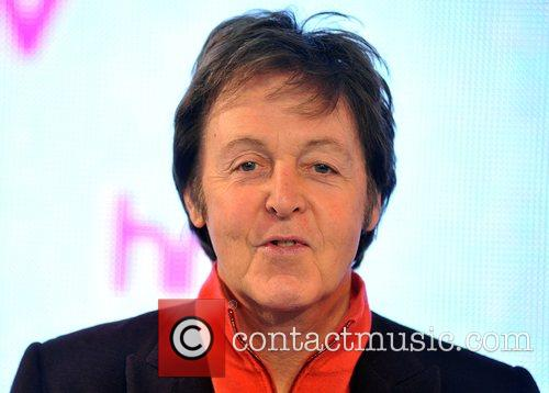 Sir Paul McCartney signs his new album Electric...