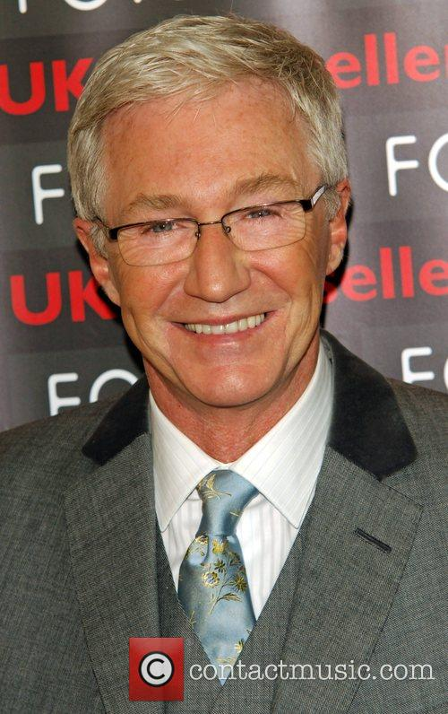 Signs copies of his new book Paul O'Grady:...