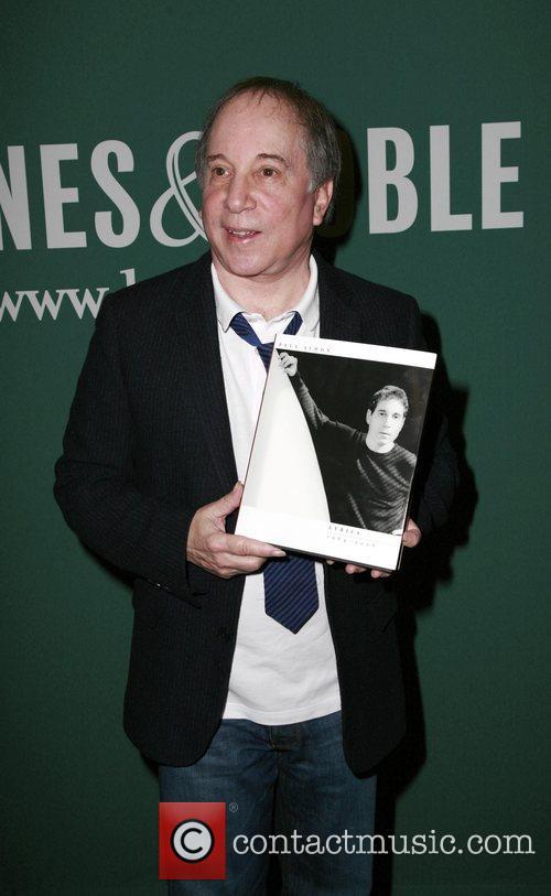 Paul Simon Signs copies of his book Paul...
