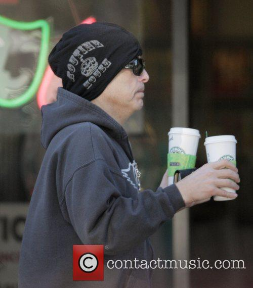 Paul Stanley carries two Starbucks Coffees on Valentine's...