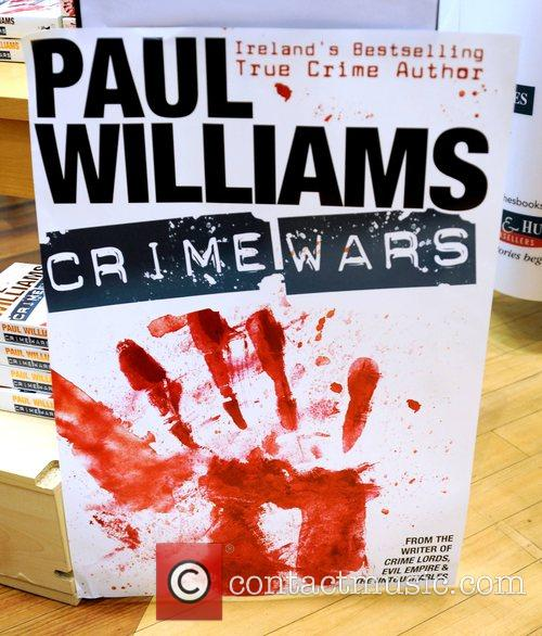 Signs copies of his latest book 'Crime Wars'...