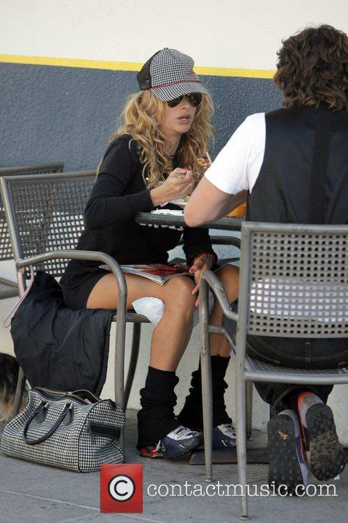 Paulina Rubio, her dog and a friend have...