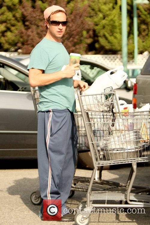 Pauly Shore shopping at Bristol Farms wearing workout...