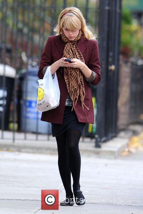 Returns to her Brooklyn home after picking up...