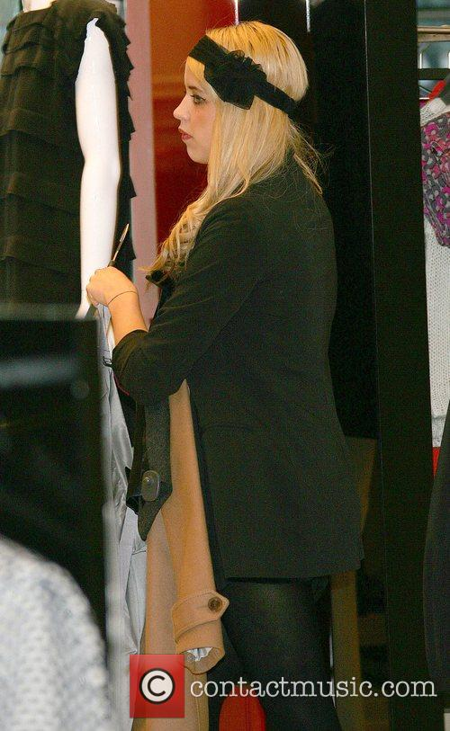 Peaches Geldof picks out clothes prior to a...