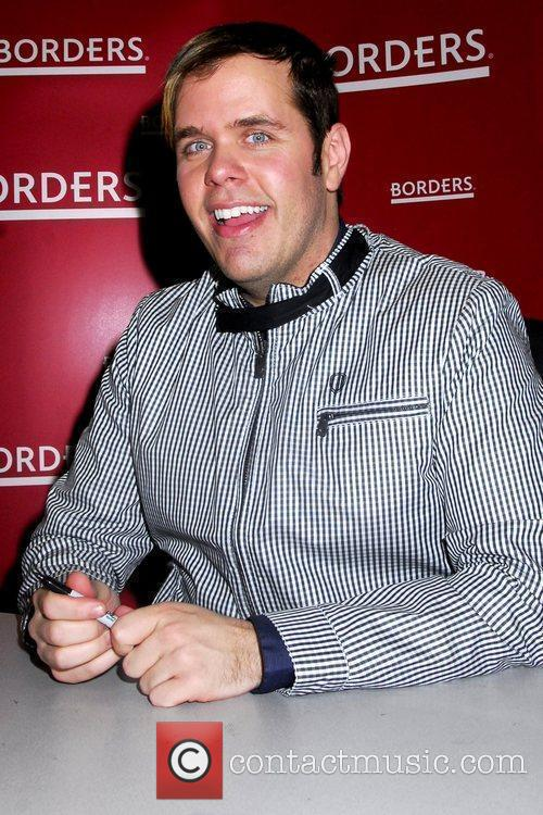 Perez Hilton Celebrity blogger signs copies of his...