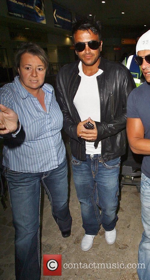 Peter Andre arrives at Heathrow Airport with his...