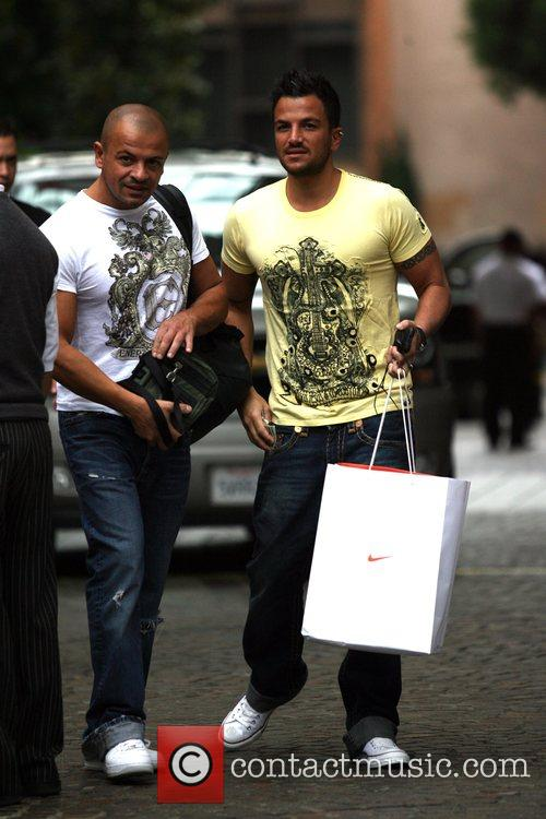 Leaving his hotel with his brother.