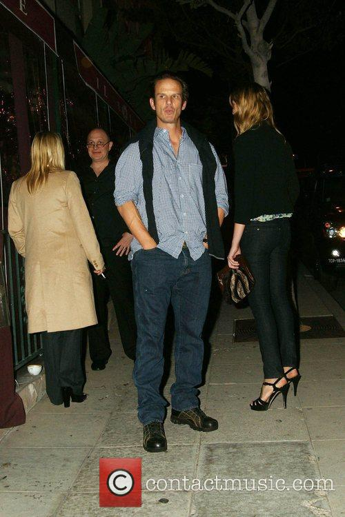 Peter Berg waiting for his car valet as...
