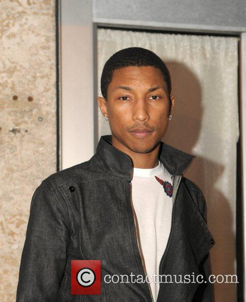 Pharrell Williams standing outside South Beach studios at...