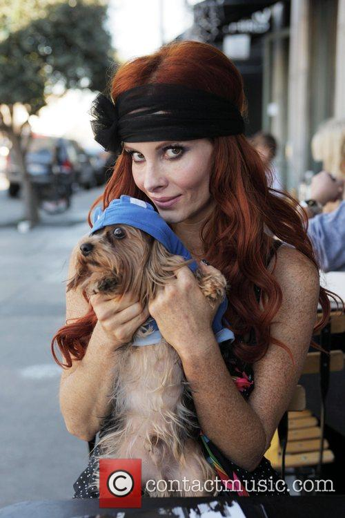 Phoebe Price and her Yorkshire terrier Henry have...