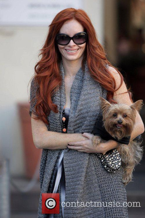Phoebe Price and her Yorkshire Terrier Henry leave...