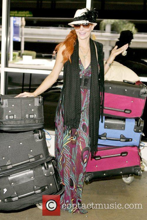 Arriving at LAX airport after returning home from...