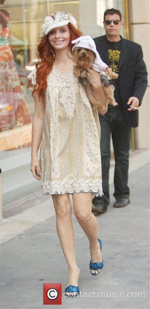Heads to a medical center with her dog,...