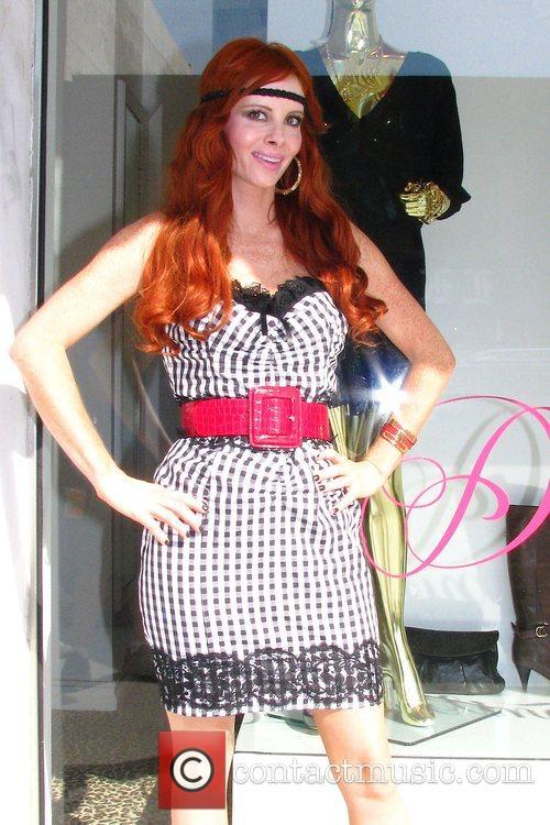 Phoebe Price delivers her custom headband line to...