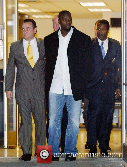 New York Giants Plaxico Burress Is In Handcuffs As He Is Led Out Of The Manhattan's 17th Precinct For Criminal Possession Of A Weapon 6