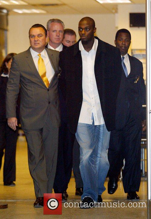 New York Giants Plaxico Burress Is In Handcuffs As He Is Led Out Of The Manhattan's 17th Precinct For Criminal Possession Of A Weapon 7