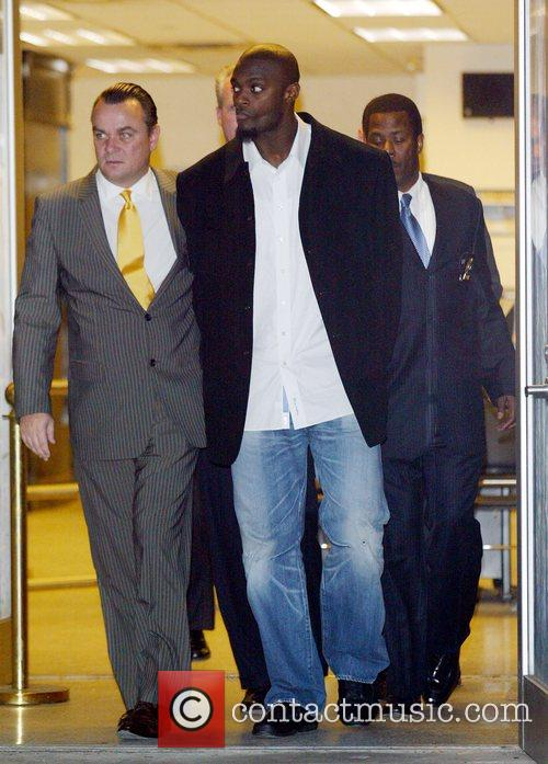 New York Giants Plaxico Burress is in handcuffs...