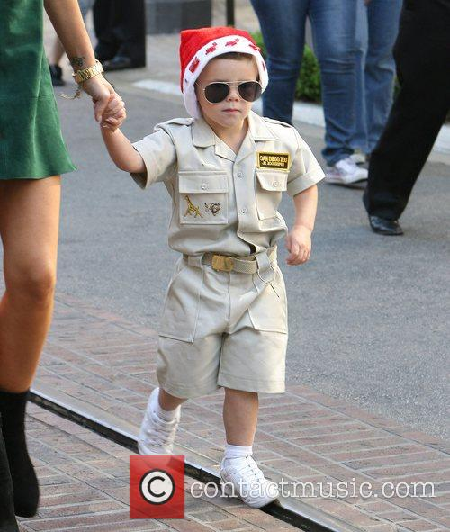 Romeo Beckham sporting a Santa hat and a...