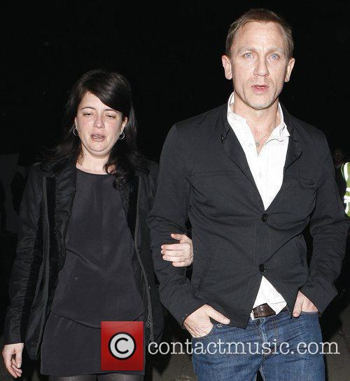 Daniel Craig and guest leave the Women in...