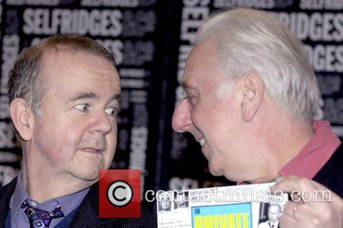 Ian Hislop and Barry Fantoni signing copies of...