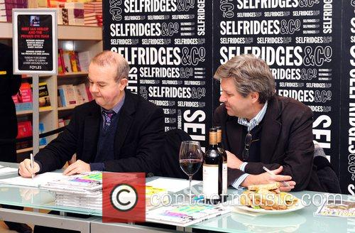 Nick Newman and Ian Hislop signing copies of...