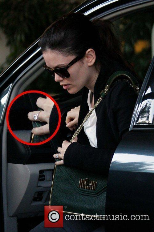 Rachel Bilson shows off her engagement ring as...