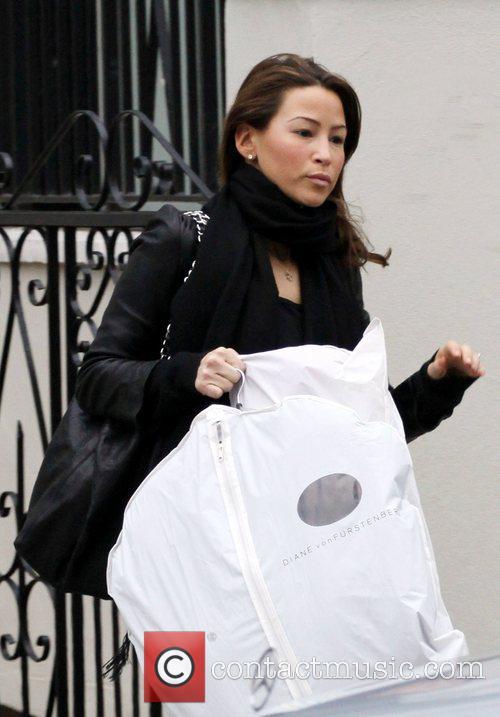 Rachel Stevens leaves her house carrying a Diane...