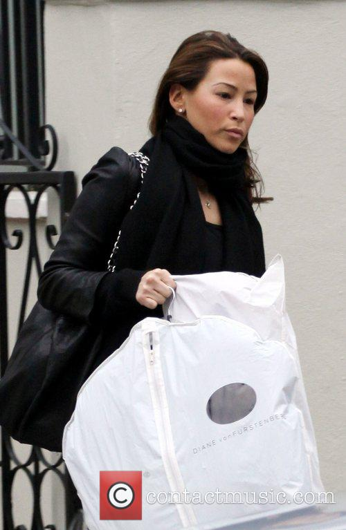 Rachel Stevens leaves her house carrying a Diane...