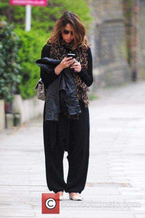 Rachel Stevens carrying two mobile phones while returning...