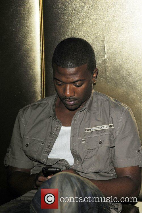 Ray J sends a text at the launch...