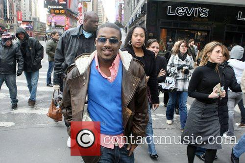 R&B Vocalist Ray J crosses the street to...