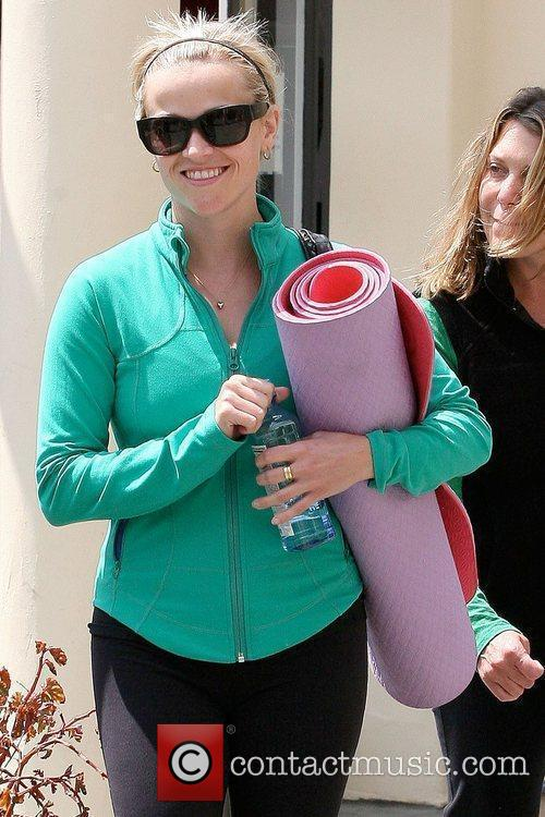 Carrying a yoga mat while leaving a gym...