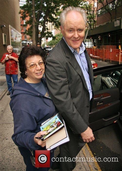 John Lithgow poses with autograph seeker Linda Rosado...