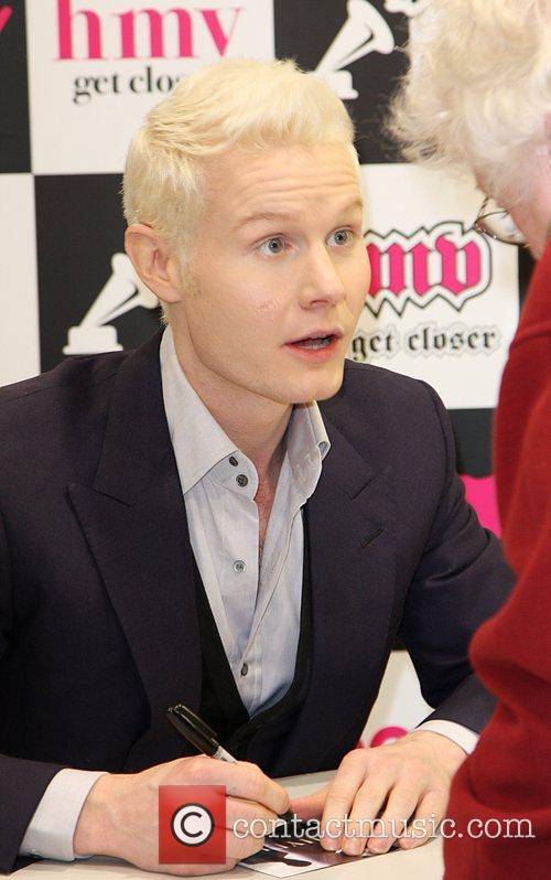 Attends a signing in HMV Cardiff for his...