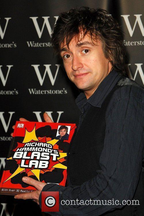 Signs copies of his new book 'Richard Hammond's...